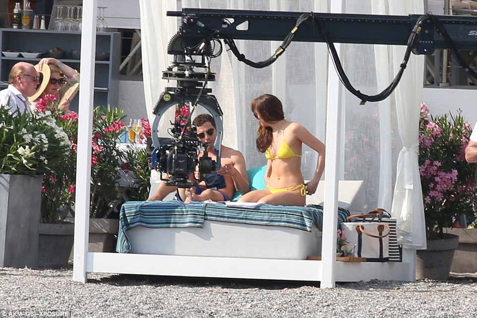 Just the two of us: The bed area was cleared of crew members while scenes were being shot