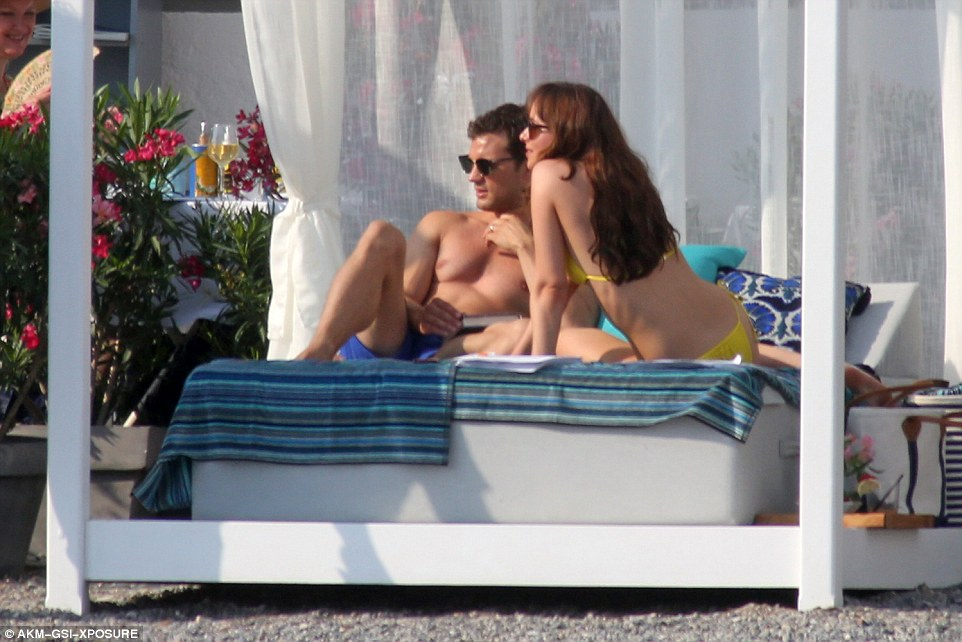 Life's a beach: The sunkissed pair looked relaxed in each other's company
