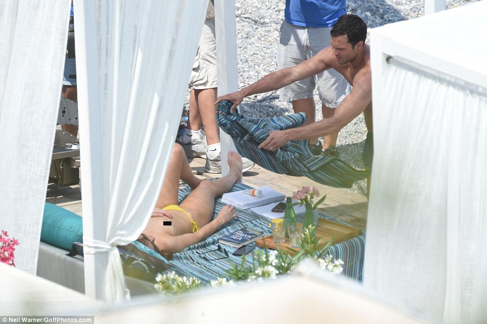 Covering up: Jamie was seen throwing a blanket over his on-screen partner