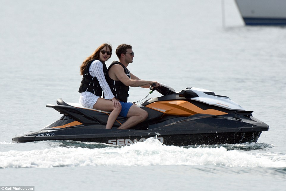 Double act: The brunette beauty put on a white cover up for the ride