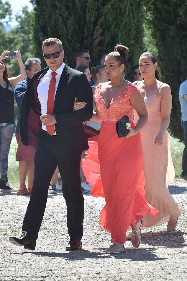 Bright sparks: Another female guest stood out in a coral gown