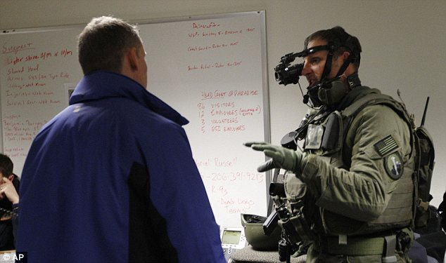 High tech search: An FBI Swat team member shows his night-vision gear in the search for a gunman on the loose in Mount Rainier National Park