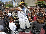 FILE - In this June 22, 2016, file photo, Cleveland Cavaliers' LeBron James, center, stands in the back of a Rolls-Royce as it makes it way through the crowd during a parade in downtown Cleveland celebrating the team's NBA championship. A person familiar with the contract says James has agreed to a three-year, $100 million contract with the Cavaliers. The person says James, who recently led the Cavs to an NBA title--the first for a Cleveland sport team in 52 years--will soon sign the deal. The person spoke to the Associated Press Thursday on condition of anonymity because some details of the deal need to be finalized. (AP Photo/Gene J. Puskar, File)