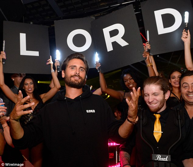 That's me: The reality star was in his element as scantily clad waitresses held up letters spelling out 'Lord'