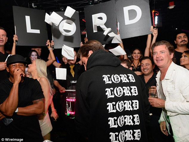 Custom-made: Scott's hoodie had the word 'Lord' printed across the back and front in white