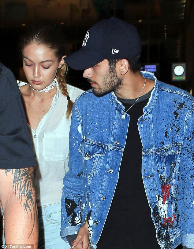 Nothing to smile about? Gigi Hadid and Zayn Malik held hands but failed to crack a smile as they flew into Los Angeles on Friday night