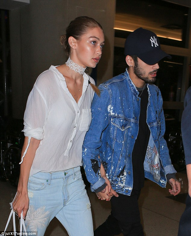 Ultra cool: The model, 21, and the musician and former One Direction member were poker-faced following their flight with Zayn, 23, pulling a baseball cap right down over his eyes