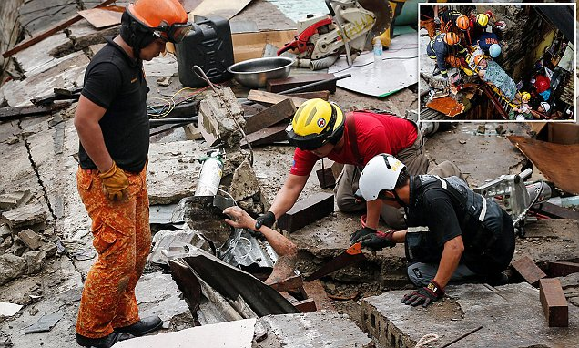 Philippines man is found alive amid the rubble of his home after a monsoon