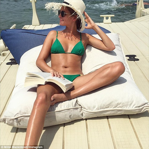 Sunning herself: Millie showed off her bronzed figure in a green two-piece