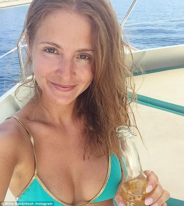 Blue-tiful!Clad in a teal bikini, showed off her perky assets and impeccably toned abs as she sipped on a beerwhilst cruising around the coast of Greece