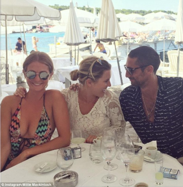 Fun in the sun: Earlier on Monday, Millie enjoyed food and drink on the beach, with pal Caggie and boyfriend Hugo