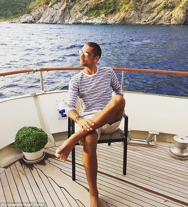 Idyllic: Hugo looked the part as he enjoys some time relaxing on the deck of a boat he and Millie appeared to have chartered earlier in the week