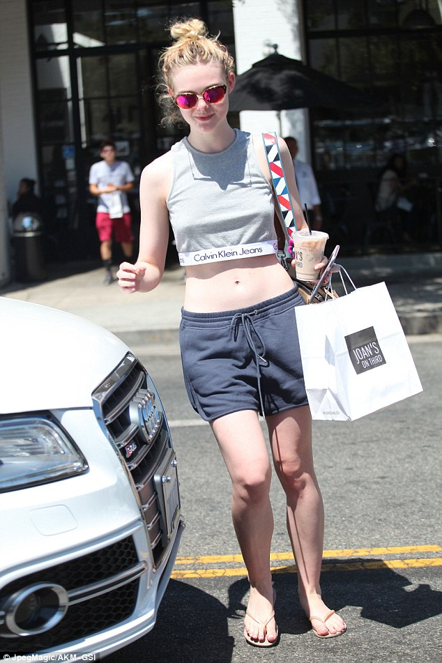 Lunch look: Elle Fanning wore a Calvin Klein crop top and apparently no brassiere underneath while out and about in Los Angeles on Friday