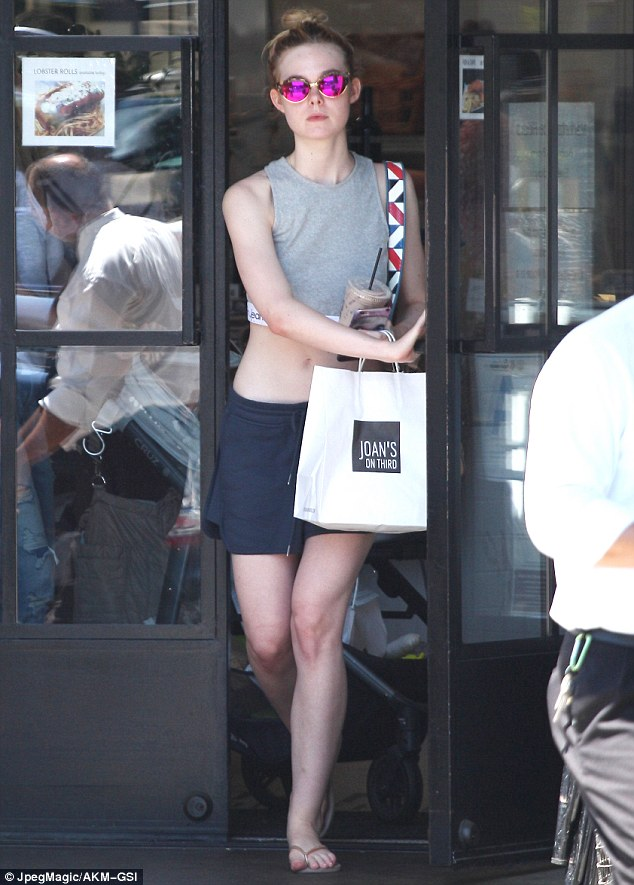 Trim tummy! The Neon Demon star also showed off her toned midsection while grabbing food to-go from Joan's On Third