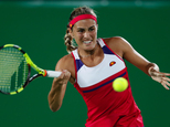 Monica Puig of Puerto Rico returns to Germany's Angelique Kerber in the gold medal match of the women's tennis competition at the 2016 Summer Olympics in Rio de Janeiro, Brazil, Saturday, Aug. 13, 2016. (AP Photo/Vadim Ghirda)