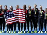 Emily Regan, Kerry Simmonds, Amanda Polk, Lauren Schmetterling, Tessa Gobbo, Meghan Musnicki, Eleanor Logan, Amanda Elmore and Katelin Snyder, of United States, celebrate winning gold in the women's rowing eight during the 2016 Summer Olympics in Rio de Janeiro, Brazil, Saturday, Aug. 13, 2016. (AP Photo/Luca Bruno)