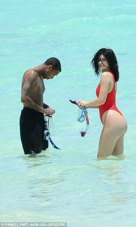 Hot stuff! Cut high on the hips, the swimsuit showed off her long, lean and sensational figure