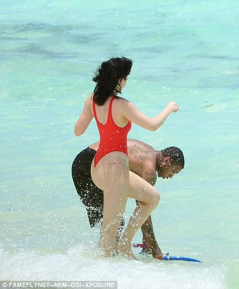 Sea views! The on-off couple frolicked in the stunning waters