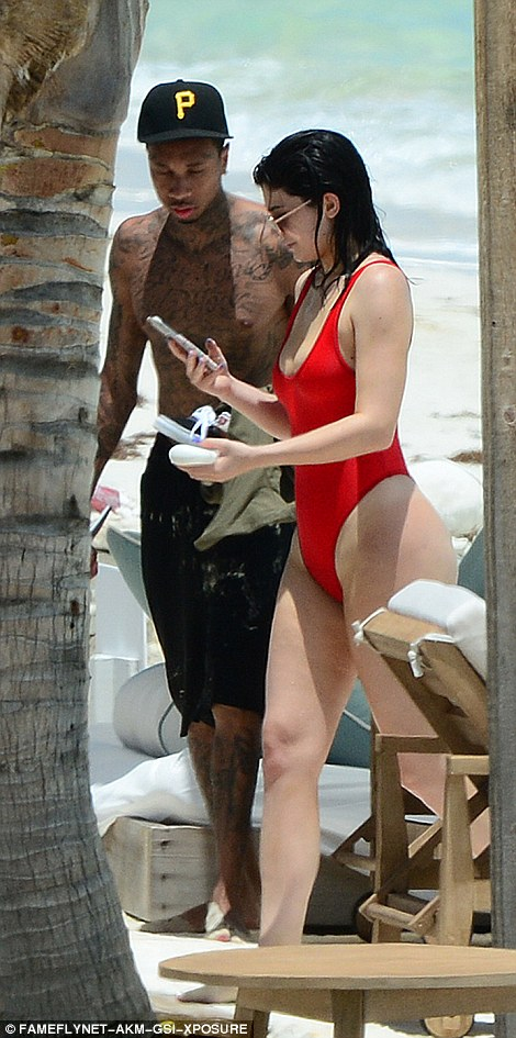 In demand! Kylie checked her phone- and perhaps her selfies