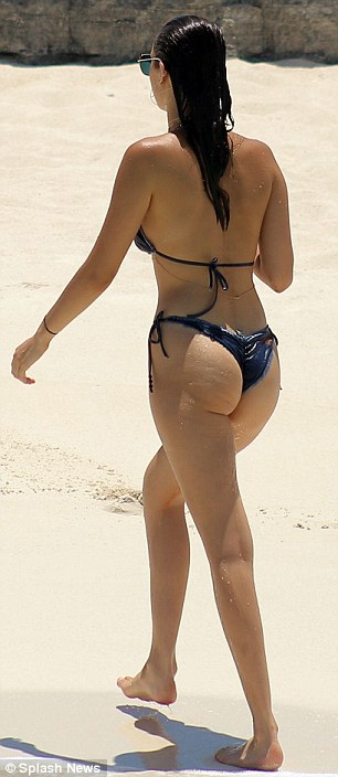 Cheeky: Bella also attempted to minimize her tan lines by scrunching up her high cut bikini bottoms even further