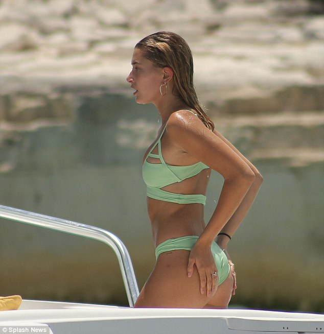 Cool girl: Hailey was a cut above in her mint green bikini that featured bold straps and cut outs