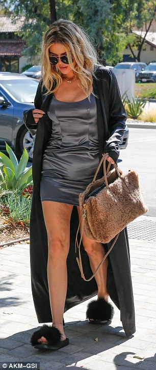 Slumber party chic:The 32-year-old Keeping Up With The Kardashians' starsported a silk negligee and robe as she made her way to work to film scenes with her family