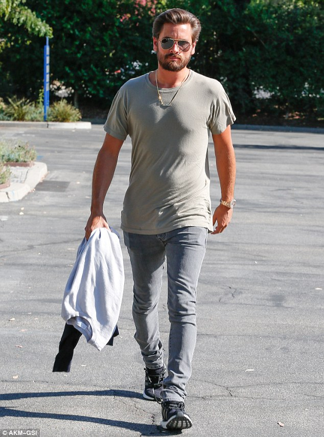 Laid-back look:Scott dressed casual for the day of filming opting for a pale green T-shirt, grey skinny jeans and trainers. The scruffy-faced hunk accessorized with gold accents