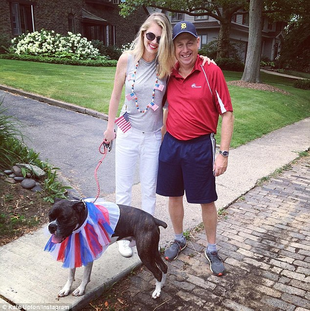 Woman's best friend: Kate adores her Boxer rescue Harley and frequently posts about her on social media - seen here dressed up for the Fourth of July with the model and her father