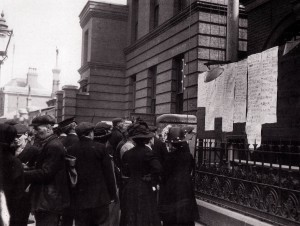 Crowds checking lists of names of those saved posted on railings outside White Star's Southampton offices