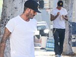 *EXCLUSIVE* Beverly Hills, CA - David Beckham's son, Brooklyn, is known as the skater boy of the family but David Beckham could have been confused for one when he was spotted picking up a smoothie in Beverly Hills.  He was seen wearing a patch baseball cap, white tee, a chain wallet - popular amongst skaters, and green Nike sneakers.\nAKM-GSI            August 17, 2016\nTo License These Photos, Please Contact :\nMaria Buda\n(917) 242-1505\nmbuda@akmgsi.com\nsales@akmgsi.com\nMark Satter\n(317) 691-9592\nmsatter@akmgsi.com\nsales@akmgsi.com\nwww.akmgsi.com
