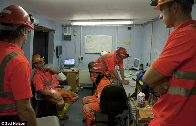 The team in the canteen before getting suited up for work in the lab