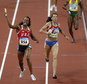 FILE - In this Aug. 23, 2008 file photo, United States' Sanya Richards, left, celebrates winning the women's 4x400-meter final at the Beijing 2008 Olympics in Beijing, China. At center is Russia's Anastasia Kapachinskaya, who took the silver, but in 2016 was retroactively disqualified after she and two other Russians tested positive in rechecks of their doping samples. (AP Photo/Kevin Frayer, File)