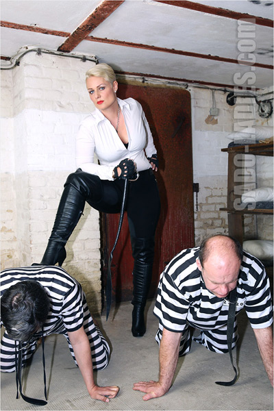 Extreme boot drill on her prisoners