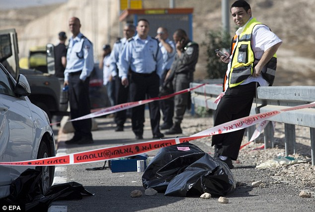 A Palestinian driving a taxi tried to run over Israelis in the east of Jerusalem - after crashing his car he got out and tried to stab people but was shot dead