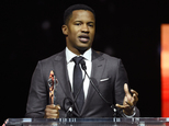 """FILE - In this April 14, 2016 file photo, Nate Parker, director of the upcoming film """"The Birth of a Nation,"""" accepts the Breakthrough Director of the Year award during the CinemaCon 2016 Big Screen Achievement Awards in Las Vegas. The American Film Institute has canceled plans to screen writer-director Nate Parker¿s ¿The Birth of a Nation¿ for students this week amid controversies surrounding a 17 year old rape accusation of Parker and his co-writer. (Photo by Chris Pizzello/Invision/AP, File)"""