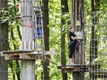 """An employee closes up the Go Ape course for the day after a 59 year-old woman fell to her death at the zip line course in Lums Pond State Park in Bear, Del., Wednesday, Aug. 24, 2016.  Jeff Davis, a spokesman for Go Ape, said Thursday, Aug. 25, 2016, that the rides are inspected on a regular basis. Davis said the Lums Pond attraction is closed for undetermined amount of time to help with the investigation, """"and also in respect to the family of the person who died."""" """"The Go Ape company is extremely saddened by this,"""" he said. (Kyle Grantham/The Wilmington News-Journal via AP)"""