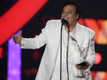 FILE- In this April 28, 2016, file photo, singer Juan Gabriel receives the Star Award at the Latin Billboard Awards, in Coral Gables, Fla. Representatives of Juan Gabriel have reported Sunday, Aug. 28, 2016, that he has died. Gabriel was Mexico's leading singer-songwriter and top-selling artist with sales of more than 100 million albums. The statement says he died Sunday, but did not say where. (AP Photo/Wilfredo Lee,File)
