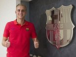 The 27-year-old Dutchman poses for a picture after signing five-year deal at the Nou Camp