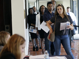 In this Tuesday, July 19, 2016, photo, Raisa Rickie waits in line to apply for a job with Aldi at a job fair in Miami Lakes, Fla. On Friday, Sept. 2, 2016, the U.S. government issues the August jobs report. (AP Photo/Lynne Sladky)