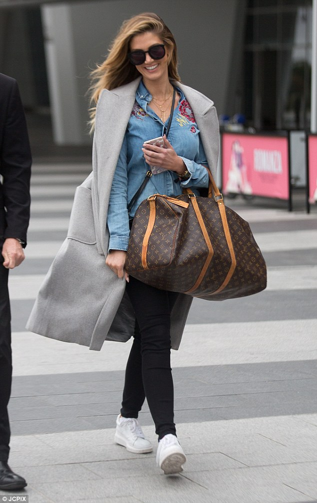 Flying solo!Delta Goodrem was all smiles as she jetted into Adelaide alone on Saturday dressed in a very stylish outfit, flaunting her trim pins and designer luggage after the flight