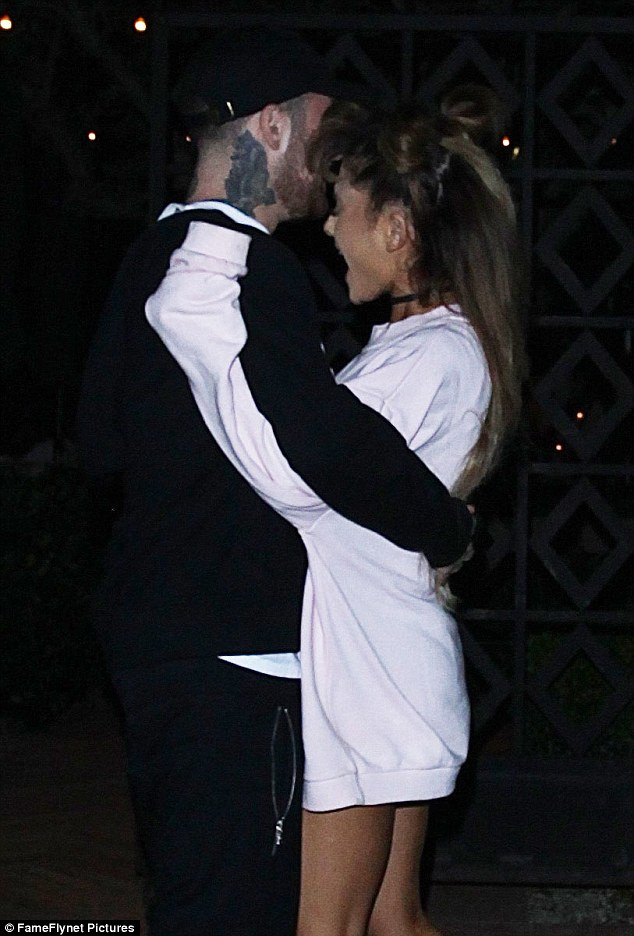 All eyes on her: Mac's attention was solely focused on his leading lady, as he engaged in a full-on embrace with the tiny songstress
