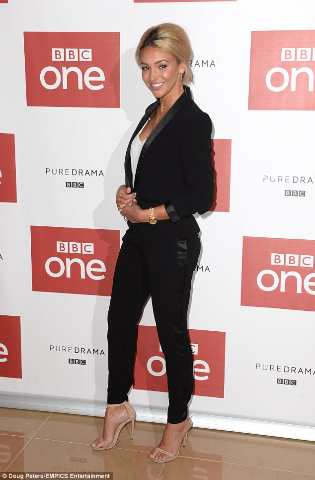 Stunner: The actress, who has just returned from a beach break with her husband in Majorca, looked incredible in a chic tuxedo as she prepped to unveil her latest work in the BBC series