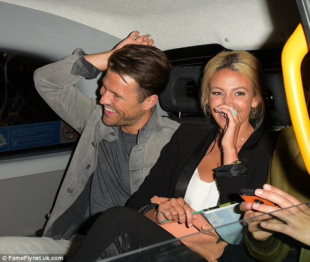 Having a giggle:It was a squeeze in the car as the whole gang looked to be heading to their next venue while cracking up with Michelle sat in the centre of the taxi