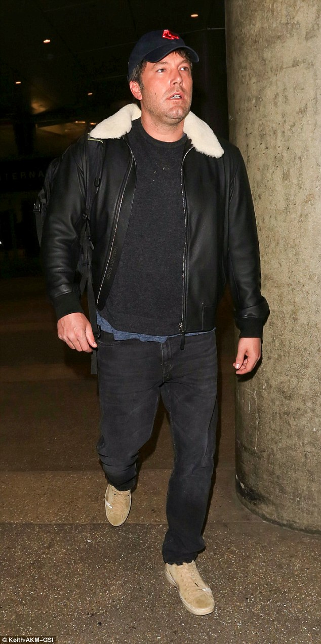 Dressed casually: The Oscar winner made his way solo through the arrivals terminal wearing dark jeans and matching t-shirt plus a leather jacket with sheepskin collar