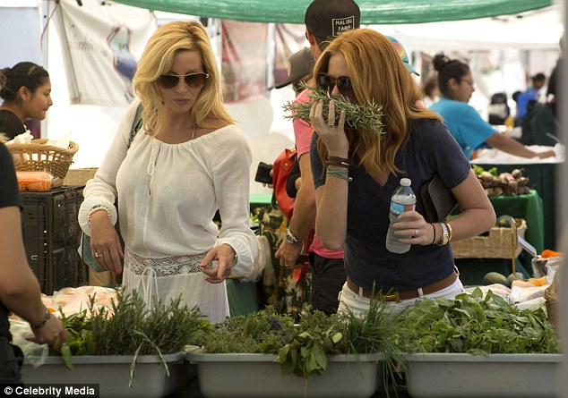 Good times: Browsing the flowers and fresh herbs, the pair seemed to be having a lovely day