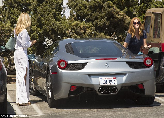 Arriving in style: Camille drove the pair to the market in her silver Ferrari