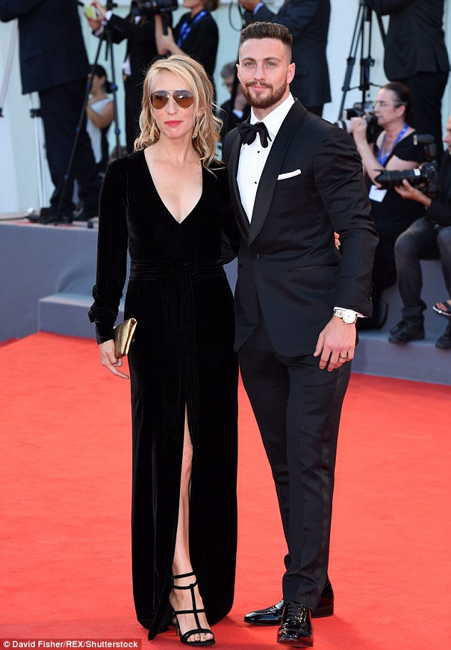 Cute couple: Sam Taylor-Johnson, 49, and her husband Aaron, 26, looked very much in love as they walked the red carpet together at the Nocturnal Animals premiere on Friday