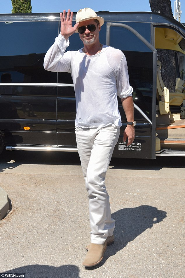 Greetings: Brad Pitt gave a jovial wave as he was seen at Zadar, Croatia airport on Friday