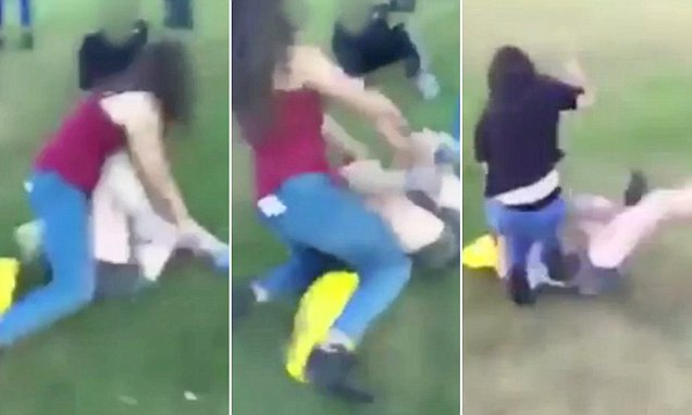 Thugs drag a girl to the ground in shockinglyviolent video uploaded to Facebook