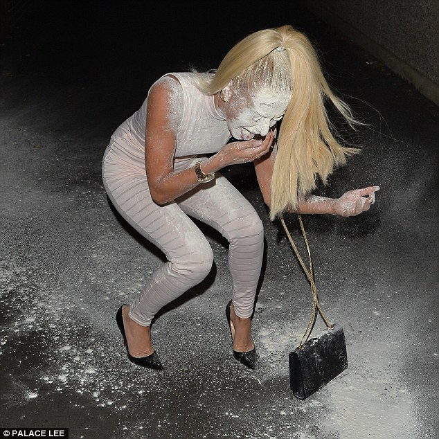Attempt: Holly stuck out her tongue to try and dust off the flour